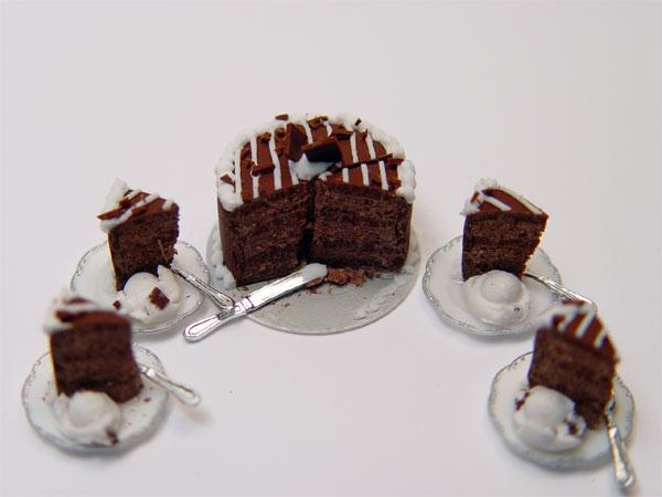 Minature Chocolate Cake W 4 Slices And Ice Cream Stewart