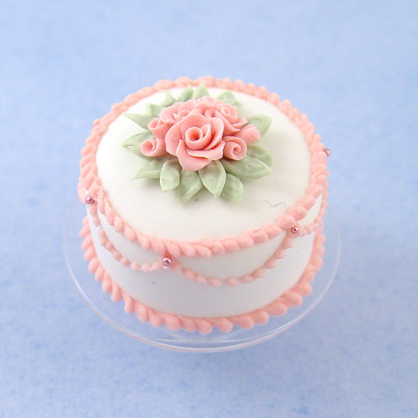 Miniature White Cake W/Pink Roses On A Glass Cake Stand