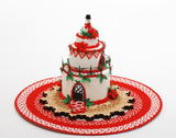 Poinsettia Cake House on a Round 1:12 scale rug.